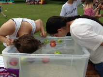 Apple bobbing - a real English fete tradition and some very wet children!