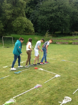 Vlad leads the team building activity on the sunken lawn.